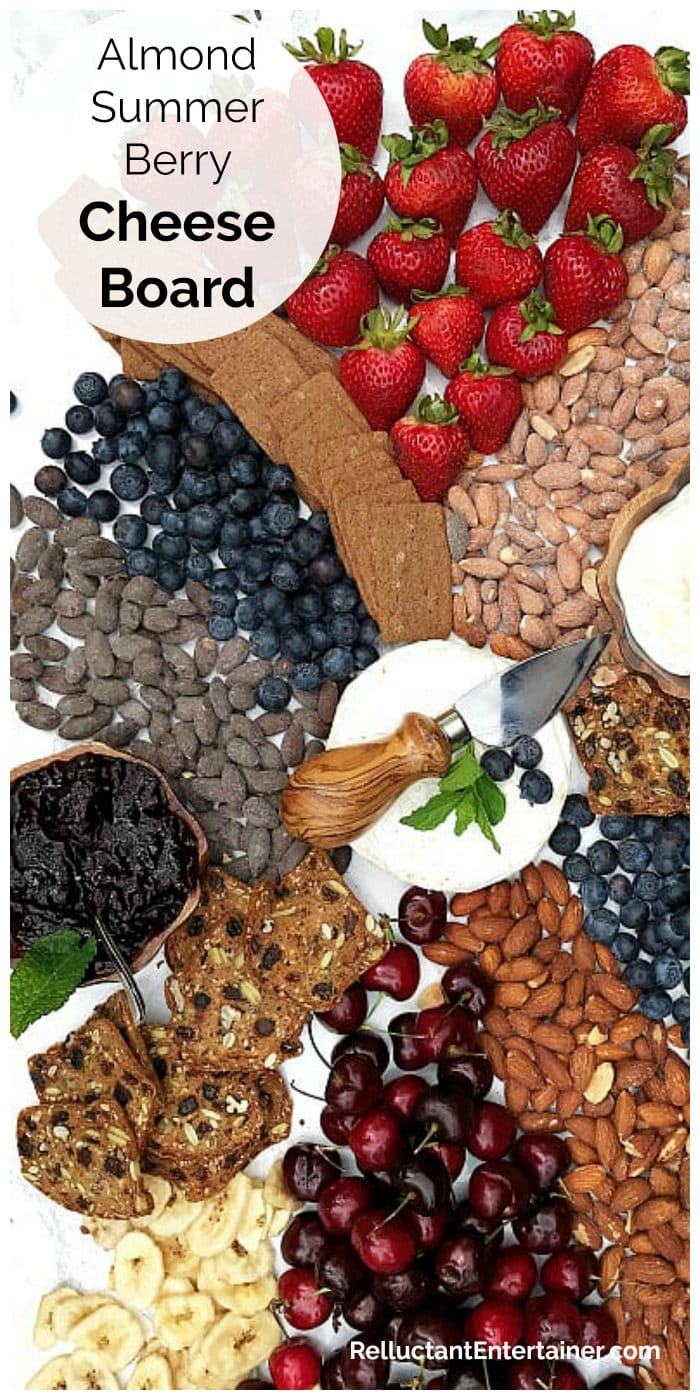 red, white, and blue cheese board with berries and almonds