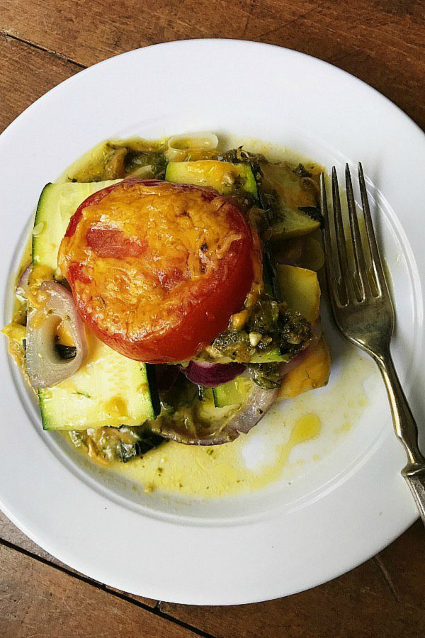 white plate with a serving of summer squash casserole
