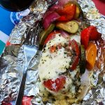 foil pack dinner of caprese chicken wrapped in foil