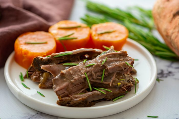 roast beef with sweet potatoes on a plate