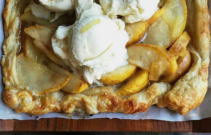 puff pastry baked with sliced pear, lemon, and ginger, served with vanilla ice cream