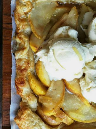 square puff pastry with pear filling and scoop of ice cream