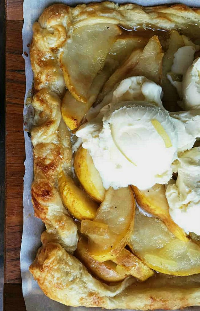 golden puff pastry dessert with pears and ice cream