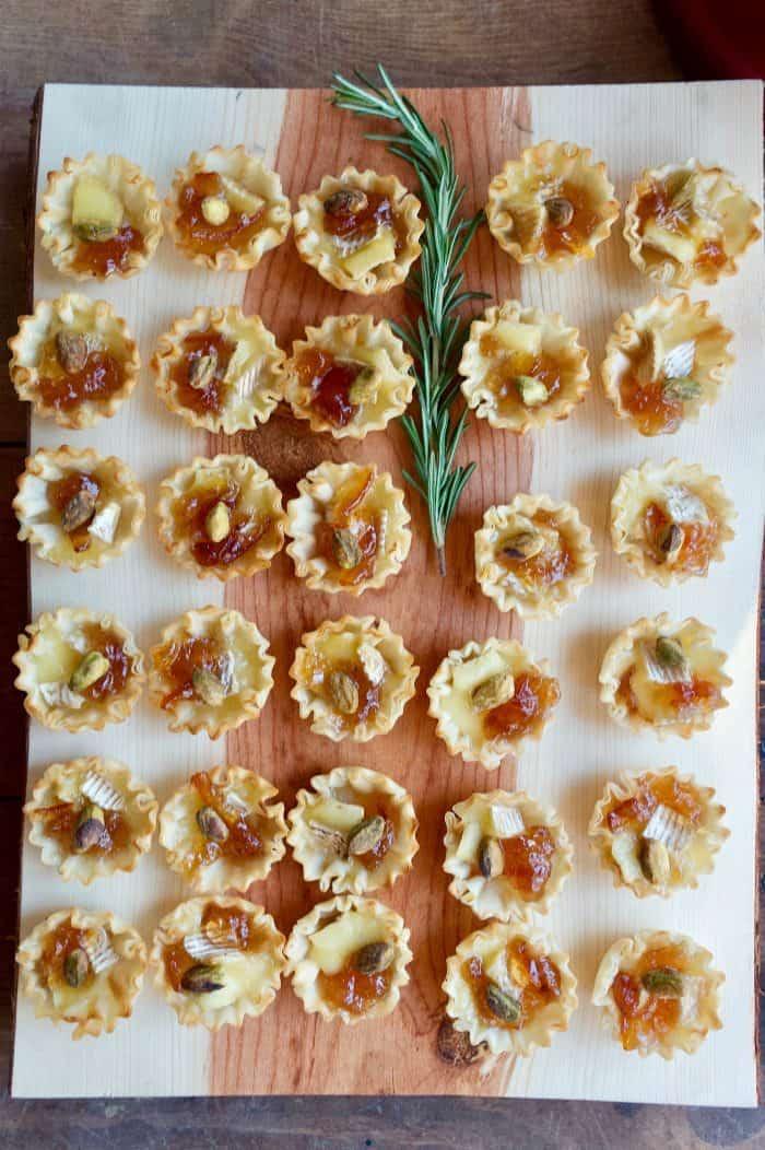 Marmalade Pistachio Brie Mini Tartlets on wood tray
