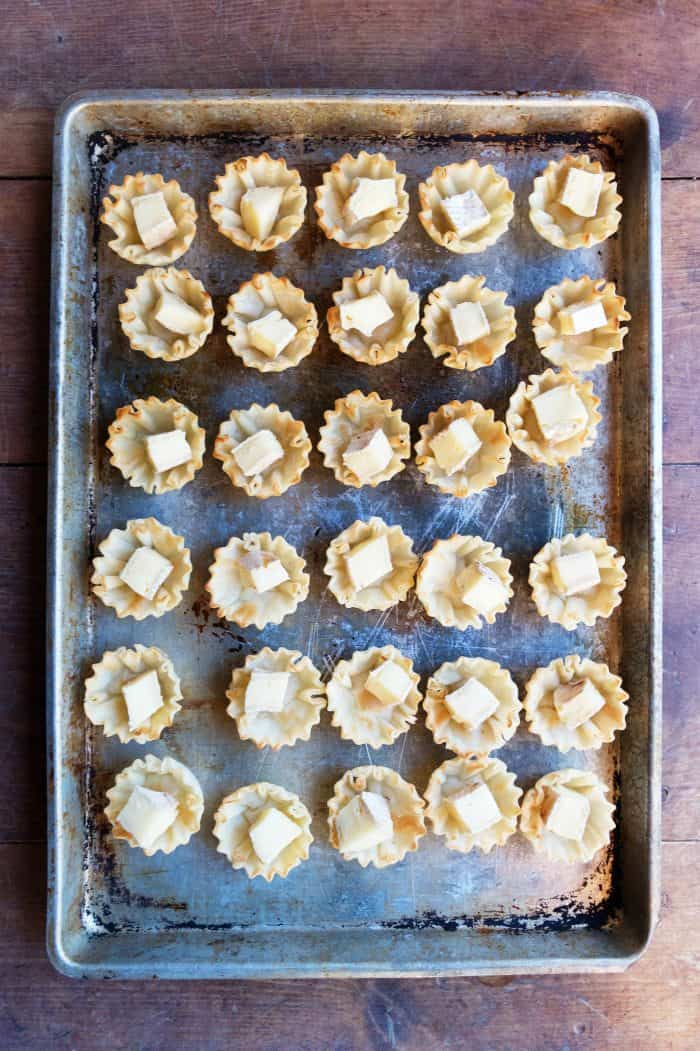 cookie sheet of Marmalade Pistachio Brie Mini Tartlets