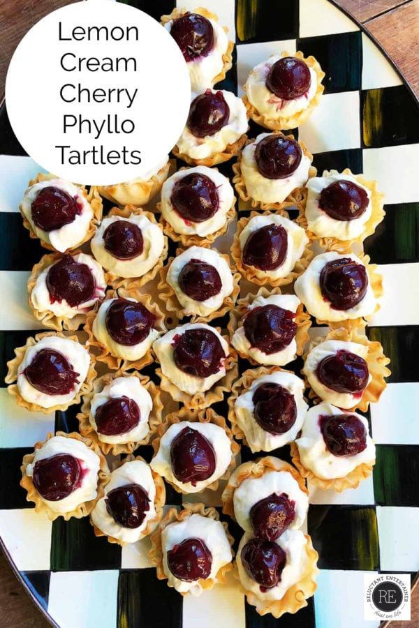black and white tray of Lemon Cream Cherry Phyllo Tartlets