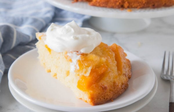 peach cake slice with whipped cream