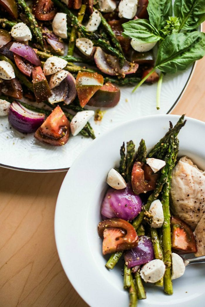 a side plate of Pesto Asparagus Caprese Salad Recipe with chicken breast