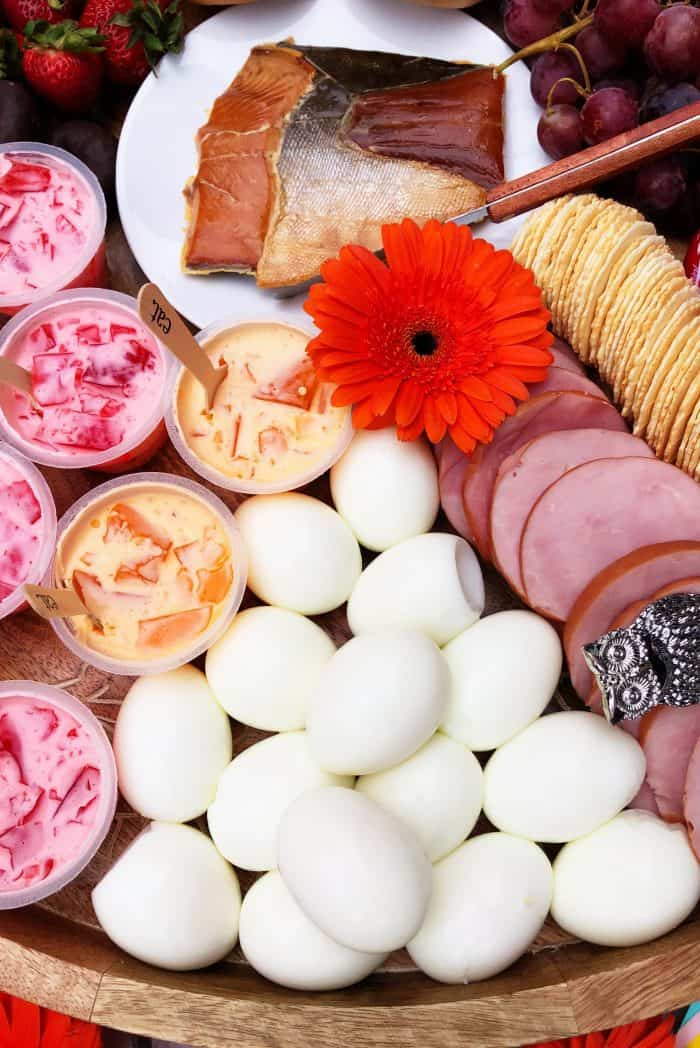 Best Sunday Brunch Cheese Board with soft boiled eggs, smoked salmon, yogurt cups