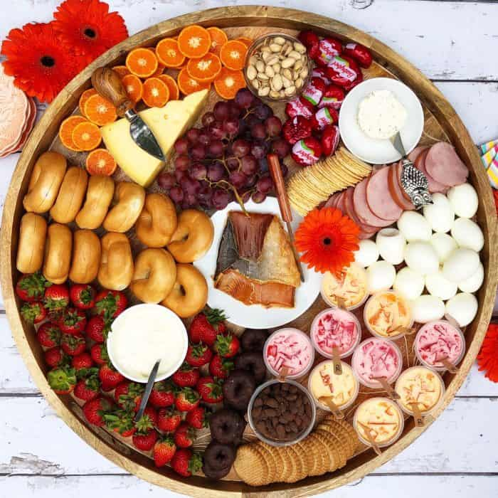 Cheese Board with salmon, boiled eggs, mini bagels, and more