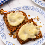2 slices of carrot cake spread with cream cheese frosting