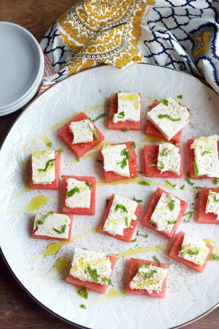 white plate of Watermelon Feta Bites Appetizer with drizzle