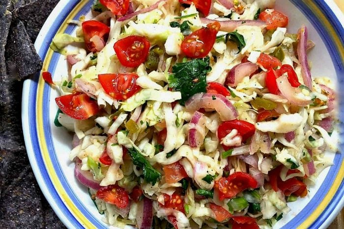 mexican bowl of mexican slaw dip with fresh tomatoes