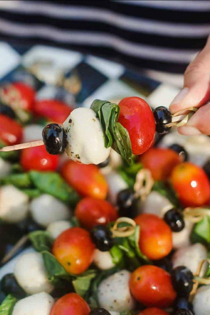 tomato, basil, mozzarella cheese, and blueberry on a mini kebab
