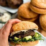 mint and lamb burger with fig jam on a toasted bun
