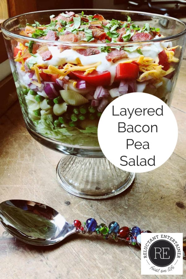 layered bacon pea salad in glass bowl