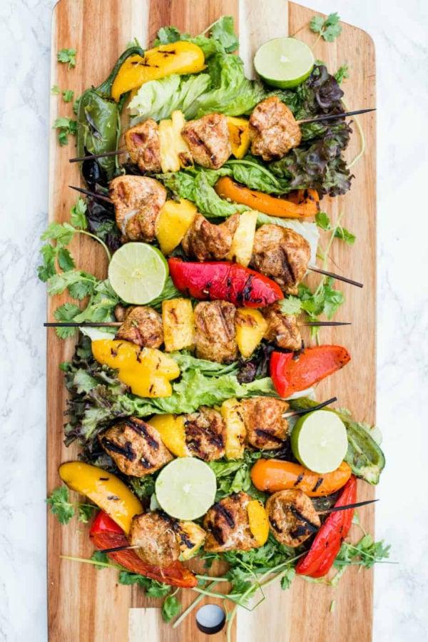 wood platter of Pineapple Mango Grilled Chicken Skewers