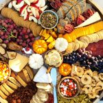 beautiful fall colors on a round charcuterie board with food