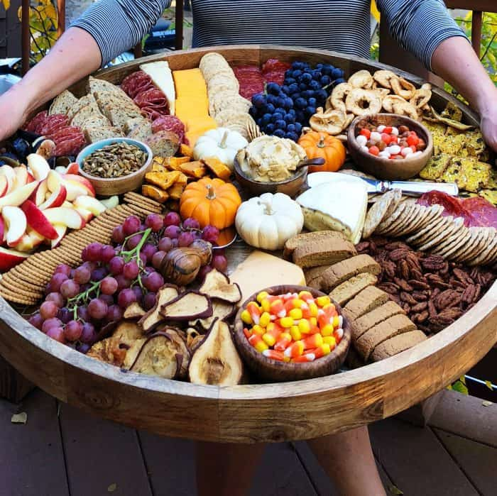 Tasty Fall Epic Charcuterie Board with grapes, crackers meat, cheese