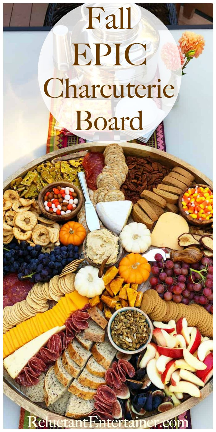 beautiful round board with fall charcuterie foods (and small pumpkins for garnish)