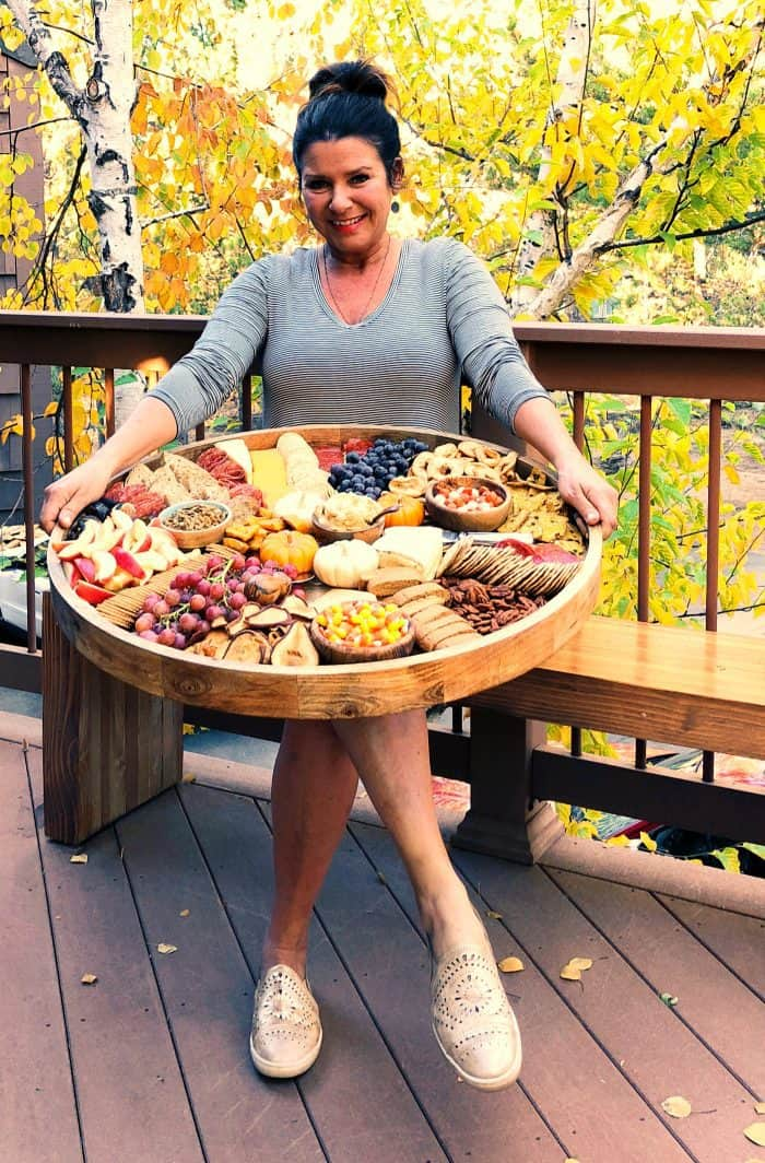 woman holding an Epic Charcuterie Board