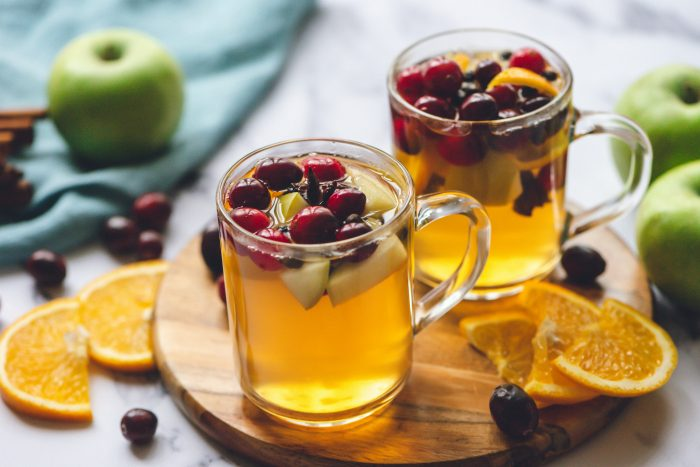 2 clear mugs with mulled cider