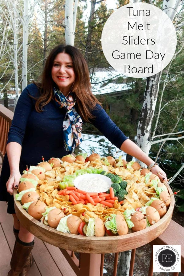 woman holding large serving tray of tuna melt sliders