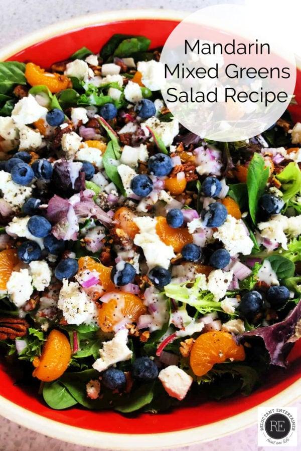 orange bowl of Mandarin Mixed Greens Salad Recipe