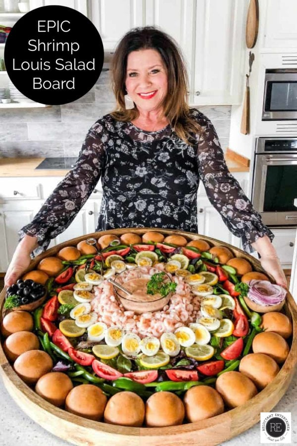 woman holding an epic shrimp salad board
