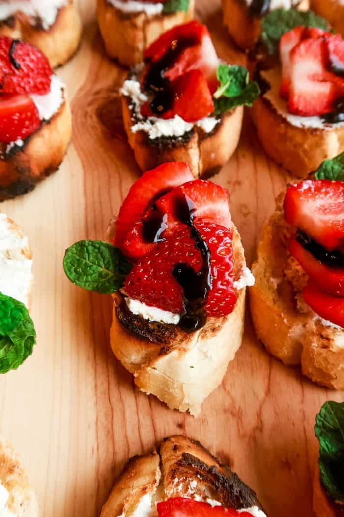 a platter of Strawberry Bruschetta with Goat Cheese with balsamic and mint