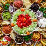 beautiful round taco spread on an epic board