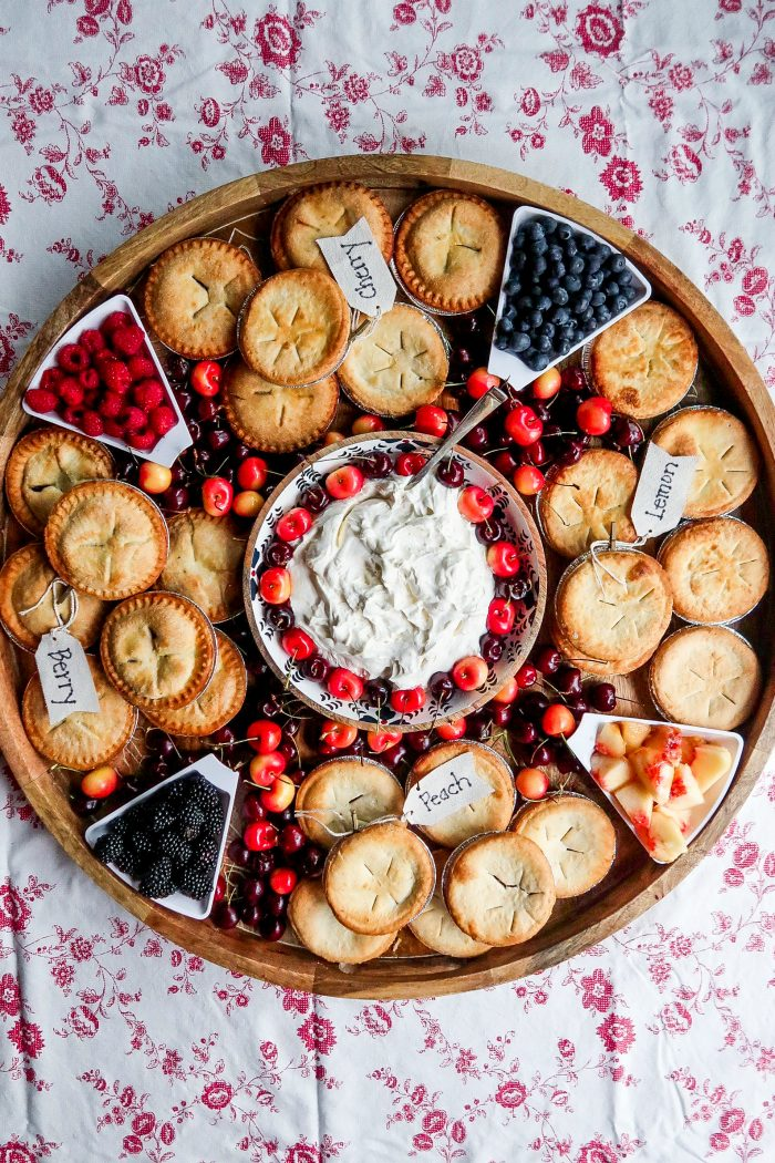 an epic mini pie board with whipped cream