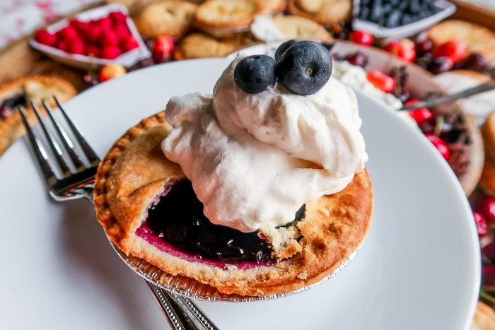 mini berry pie with whipped cream