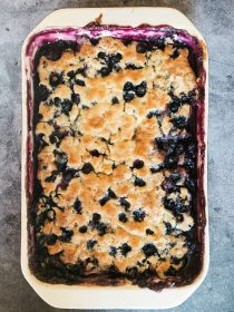 blueberry cobbler with a brown crusty topping
