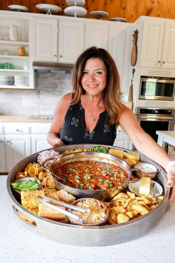 woman holidng a chili board