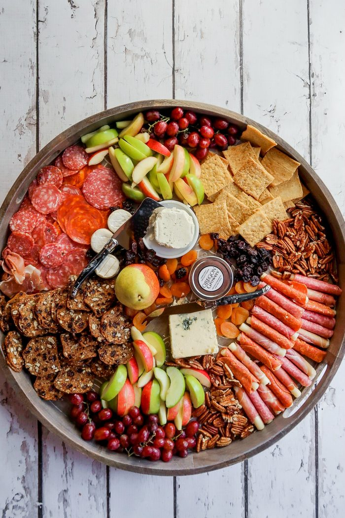 Round Fall Cheese Board with crackers, meat, and cheese