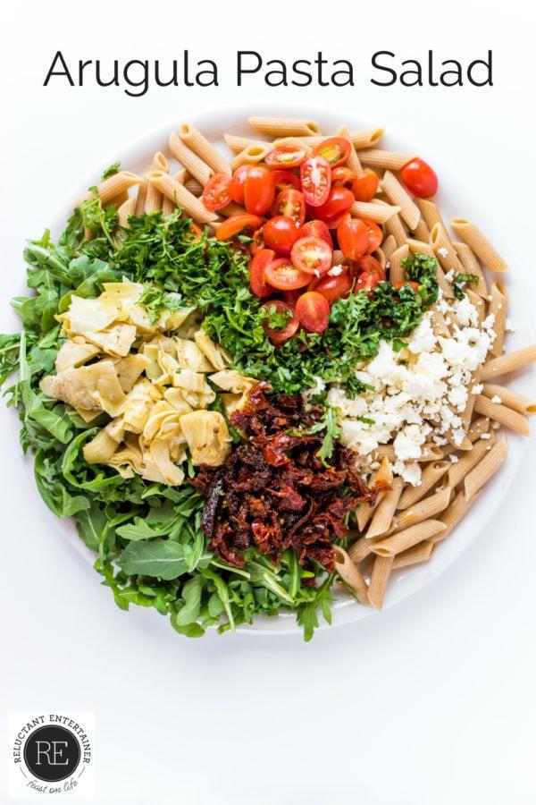 round plate of arugula pasta salad ingredients