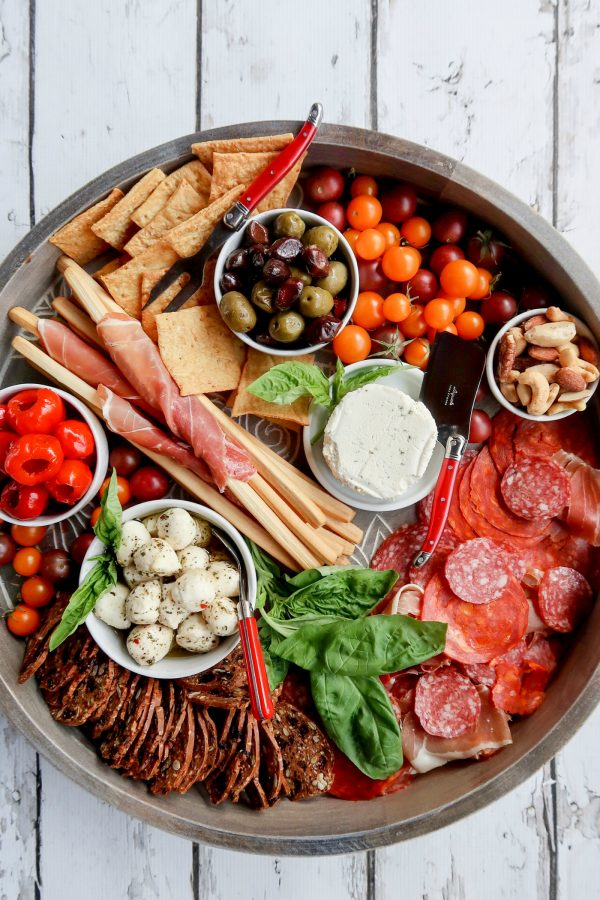 round charcuterie board with cured meats and cheese