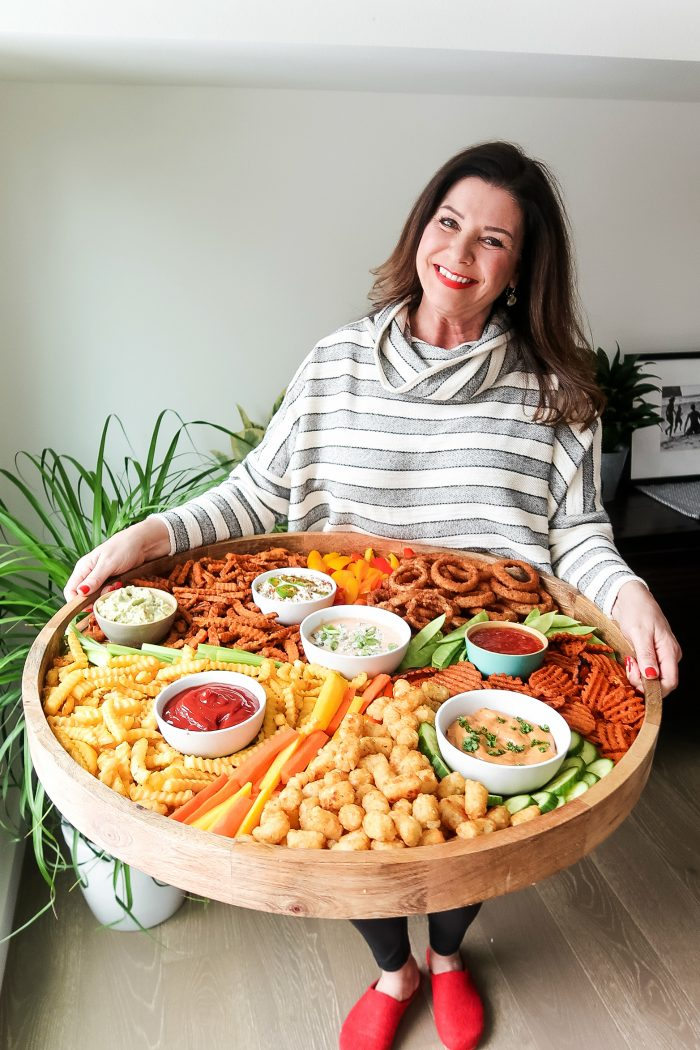 woman holding large french fries board