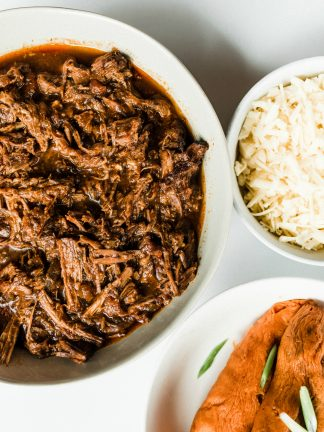 bowl of shredded instant pot chuck roast with sweet potatoes and a bowl of cheese