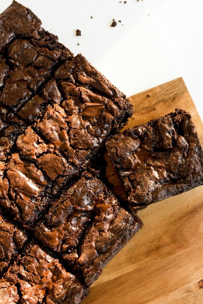 overview of brownies on a wood cutting board
