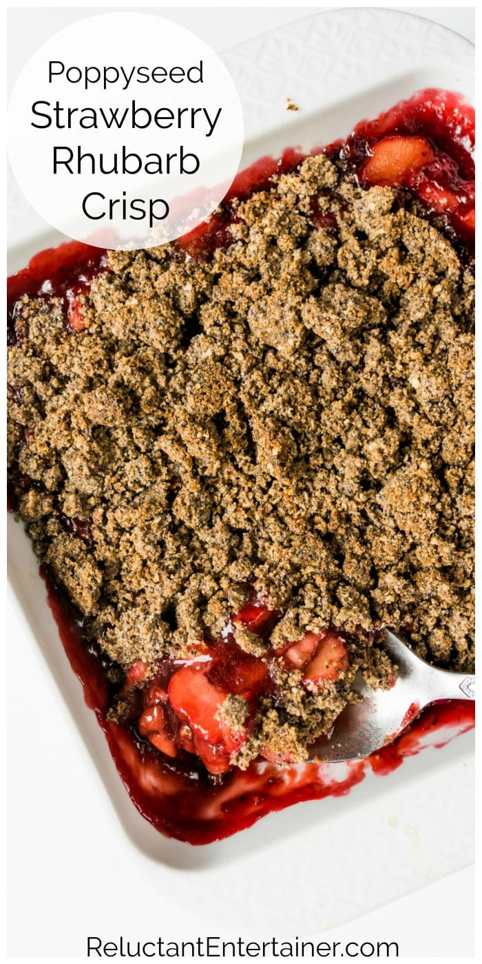 close up spoonful of strawberry rhubarb crisp