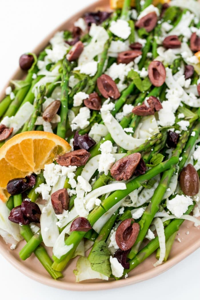 close up view of Shaved Fennel Asparagus Salad with kalamata olives and feta cheese