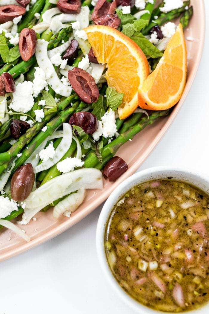 Shaved Fennel Asparagus Salad with small bowl of orange dressing