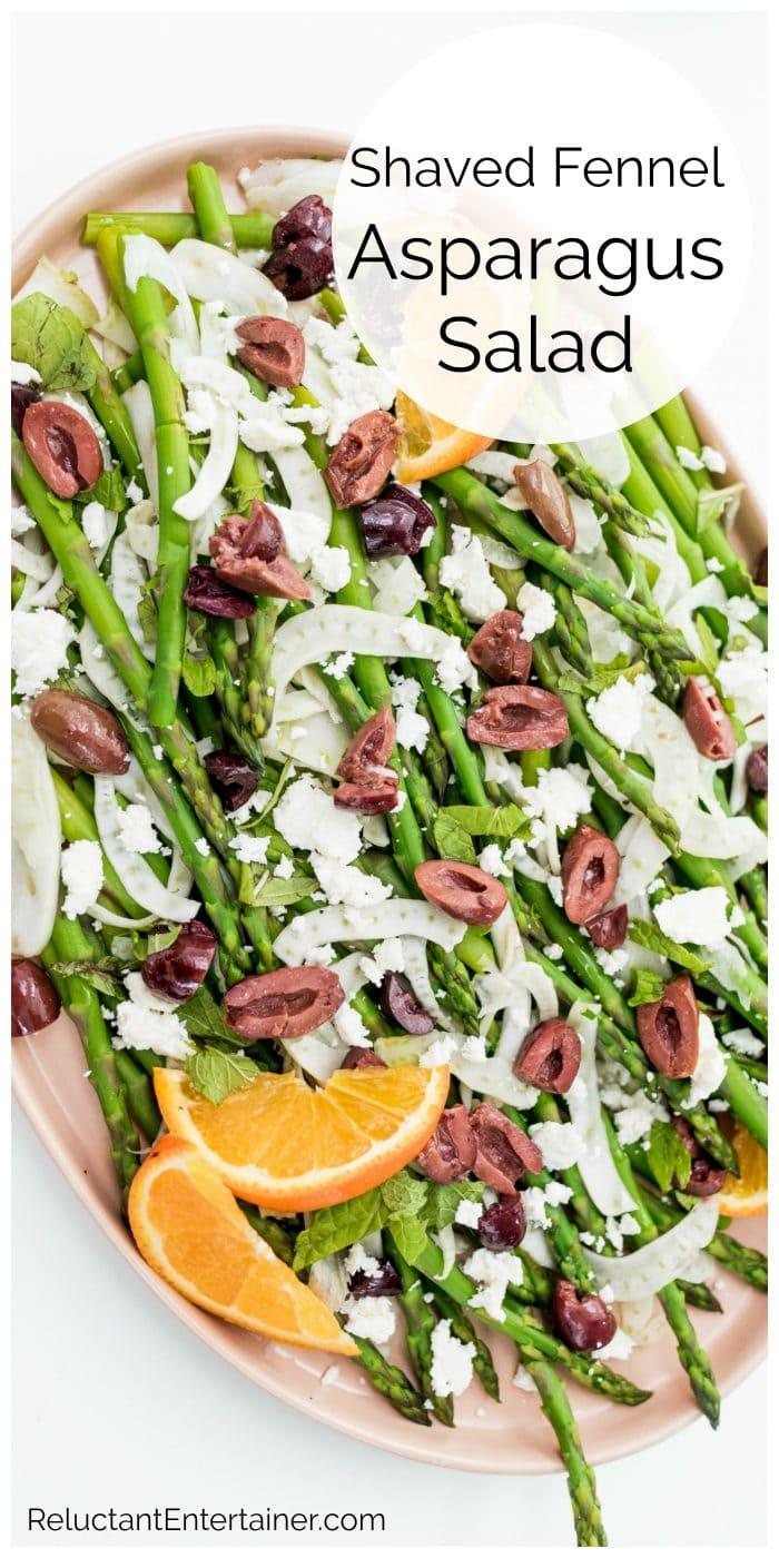 close up of Shaved Fennel Asparagus Salad with a slice of orange