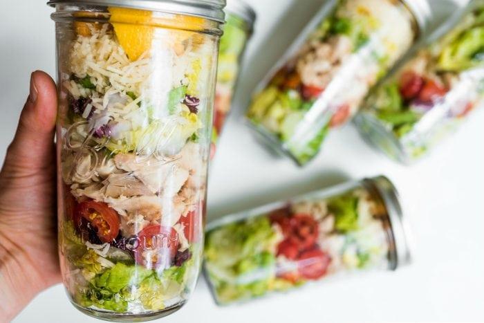 a layered chicken caesar salad