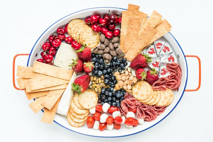 oval cheese tray with crackers and red, white, and blue foods