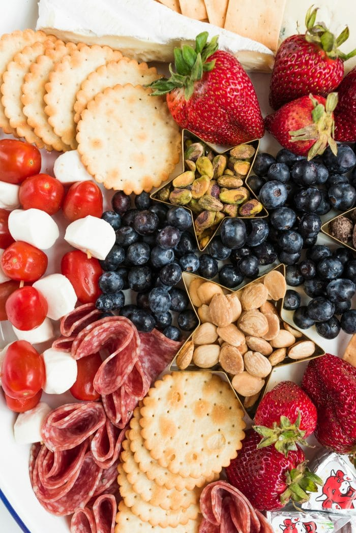 red, white, and blue cheese, crackers, and fruit