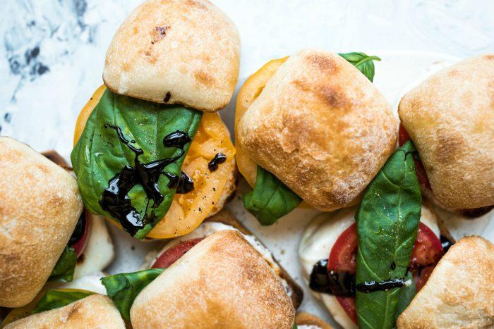 caprese sandwich sliders with yelllow heirloom tomatoes