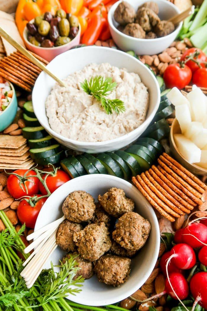 vegan hummus and meatballs on a veggie platter